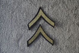 Private rank insignia.
