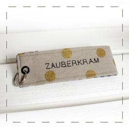 "Schlüsselanhänger - grau gold ""Zauberkram"""