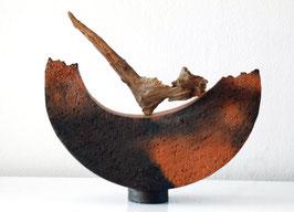 Schiff mit Treibholz