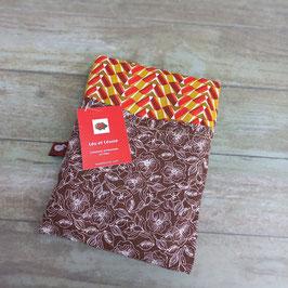 Bouillotte aux graines de lin bio en coton imprimé de taches rouge orange, vert, marron