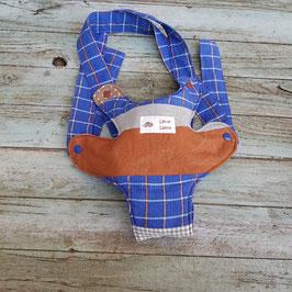 Porte doudou patchwork de différents tissus bleus et marron