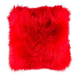 Coussin en fourrure naturelle de mouton teintée rouge
