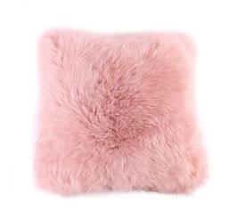 Coussin en fourrure naturelle de mouton rose poudré