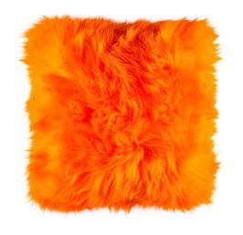Coussin en fourrure de mouton naturelle teintée orange