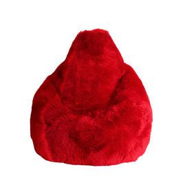 Bean bag en forme de poire en fourrure naturelle de mouton teintée rouge ferrari fabriqué en France