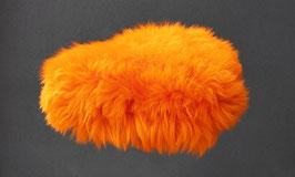 Couvre selle de vélo en peau de mouton teintée orange à poils longs