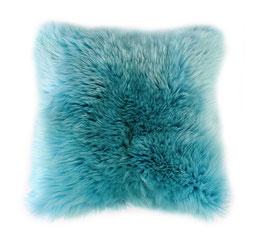 Coussin en fourrure naturelle de mouton turquoise