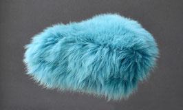 Couvre selle de vélo en peau de mouton teintée turquoise à poils longs