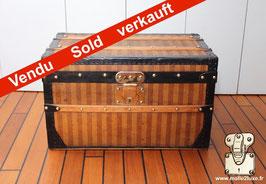 Malle Louis Vuitton rayée