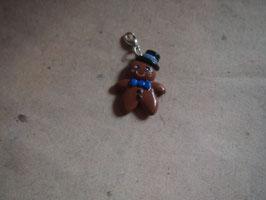 Charm Lebkuchenmann gross dunkel mit blauer Schleife