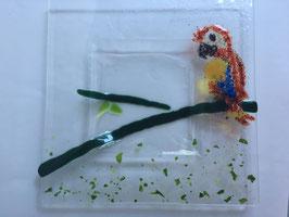 Glasschale mit Papagei
