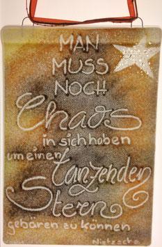 """Schild: """"Man muss noch Chaos in sich haben um einen tanzenden Stern zu gebären."""""""
