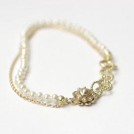 Zeeuwse knoop gouden armband met witte pareltjes