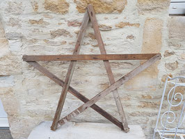 Grande étoile en bois ancien