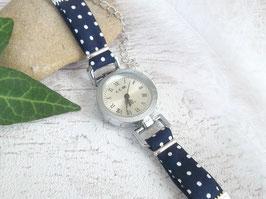 Montre bracelet marine à pois blancs