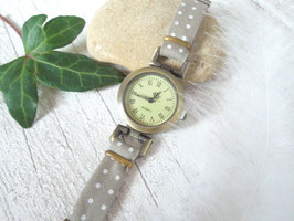 Montre bracelet taupe à pois blancs