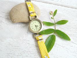 Montre bracelet jaune et bronze