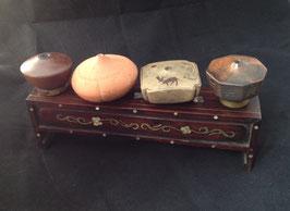 Porte-fourneaux à opium à quatre trous