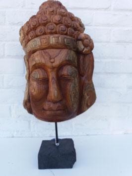 Tête de bouddha racine sur pied en pierre 1