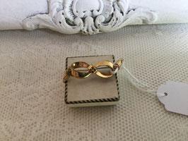 nr: II04 vintage broche strikje goudkleurig gemerkt
