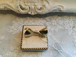 nr: 238 oude broche goud strikje met strass.