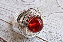 Bernstein Ring Nest aus Silberdraht und Edelstahlringschiene