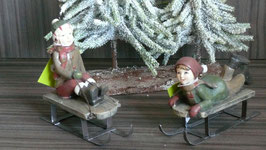 Schlittenfahrer rot-grün Kinder