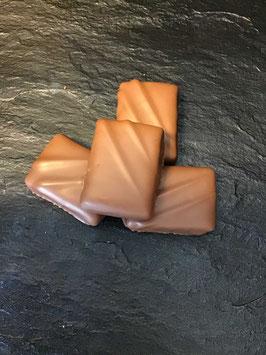 Vollmilch Schokoladenpraline  Sensation Praline Nougatine