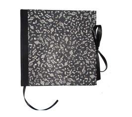 Gästebuch / Schreibbuch / Tagebuch, tanzende Noten beige auf schwarz