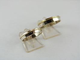 Set zilveren trouwringen met goud