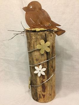 Vogel auf Holzsäule