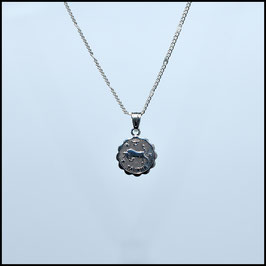 Silver necklace with vintage charm