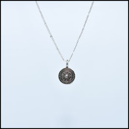 Silver necklace with flower coin