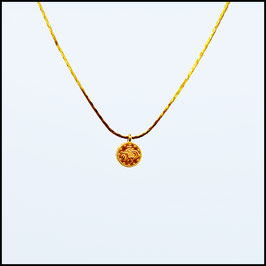 Gold necklace with small coin