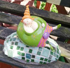 Grüner Mosaikstein mit dicker Dame