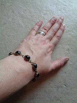 Bracelet perles noires 60's