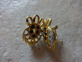 Boucles d'oreille dorées stylisées