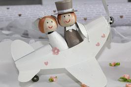Brautpaar im Flugzeug