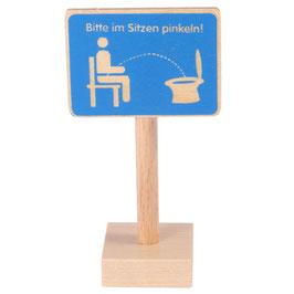 """Schild """"Im Sitzen..."""""""