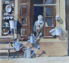Schau mal. Aquarell von Gabriele Koenigs (2019) nach einem historischen Foto, Haushaltswarenladen in Calw (1910). Im Passepartout für Bilderrahmengröße 40 x 40 cm.