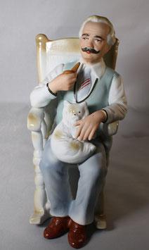 Mann im Sessel mit Katze von ARPO