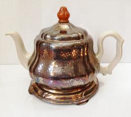 Teekanne/Warmhaltekanne mit Untersetzer, um 1940