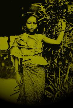 Girl posing aside blossom tree