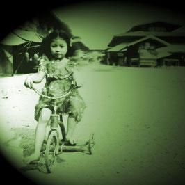Girl riding a bike in Lampang
