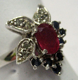 Ring with Ruby and green and blue Sapphires
