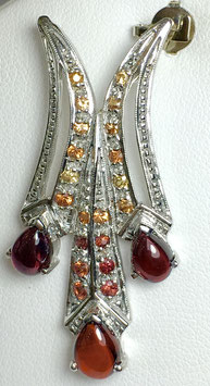 Pendant with garnet, 3,6 ct. and fancy sapphires, 0,6 ct.