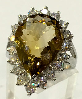 Ring with citrin 6,94 ct. and 18 cz-diamonds