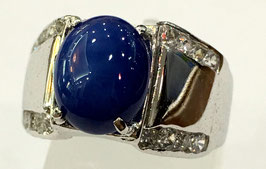 Ring with sapphire-cabochon and 16 cz-diamonds
