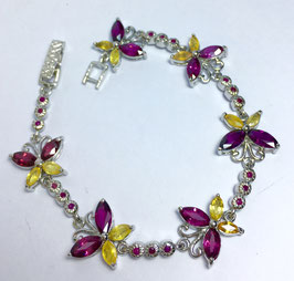 Bracelet with rhodolites, 6,6 ct., yellow sapphires, 2,25 ct.and ruby, 0,4 ct.