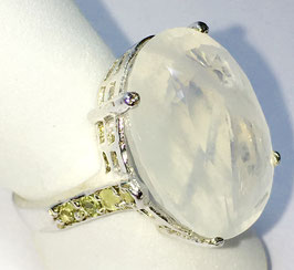 Ring with milky-quartz, 17,6 ct. and 8 small sapphire, 0,35 ct.